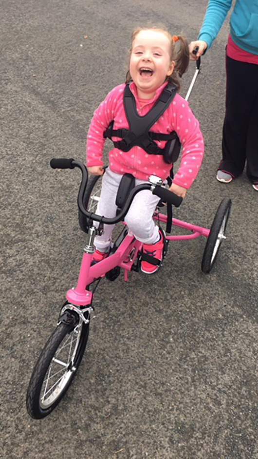 Maeve's Happy Face Says Her Tomcat Trike Is Great